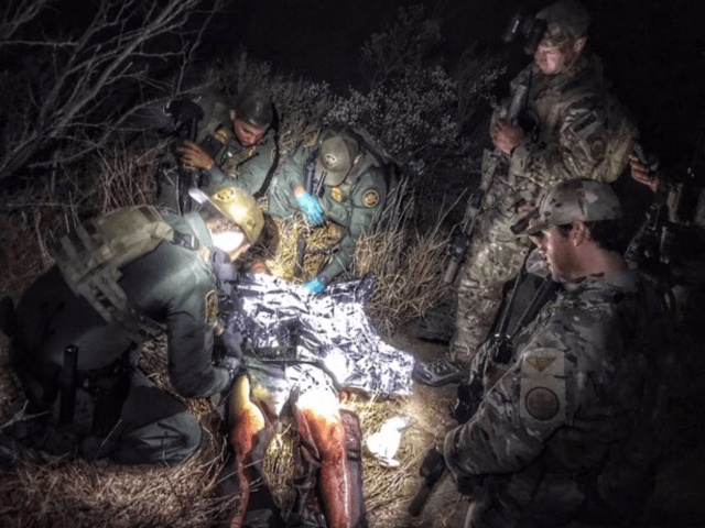 U.S. Border Patrol BORTAC agents provide medical assistance to a Los Zetas gunman who fled to Texas after being shot during a gun battle with Mexican state police. (Photo: U.S. Border Patrol/Del Rio Sector)