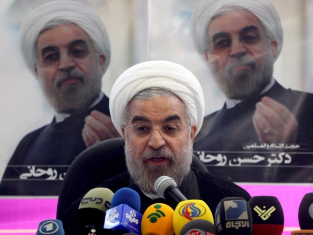 ranian presidential candidate Hasan Rouhani, a former top nuclear negotiator, speaks at a press conference at his campaign headquarters in Tehran, Iran, Saturday, June 1, 2013. The 11th presidential election after Iran's 1979 Islamic Revolution, will be held on June 14. (AP Photo/Vahid Salemi)