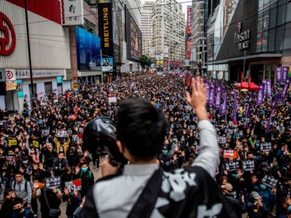 TOPSHOT - People take part in a pro-democracy march in Hong Kong on January 1, 2020. - Tens of thousands of protesters marched in Hong Kong during a massive pro-democracy rally on New Year's Day, looking to carry the momentum of their movement into 2020. (Photo by ISAAC LAWRENCE / …