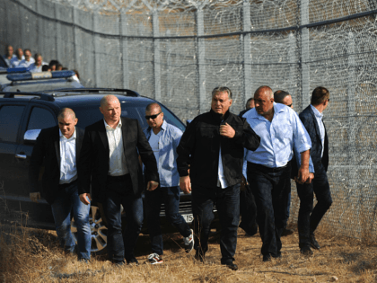 Hungary's Prime Minister Viktor Orban (C) and Bulgaria's Prime Minister Boyko Borisov (R) tour the area where a fence was erected on the Bulgaria-Turkey border near the town of Lesovo, on September 14, 2016. / AFP / NIKOLAY DOYCHINOV (Photo credit should read NIKOLAY DOYCHINOV/AFP via Getty Images)