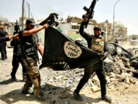 Members of the Iraqi Counter-Terrorism Service (CTS) cheer as they carry upside-down a black flag of the Islamic State (IS) group, with the destroyed Al-Nuri mosque seen in the background, in the Old City of Mosul on July 2, 2017, during the offensive to retake the city from IS fighters. …