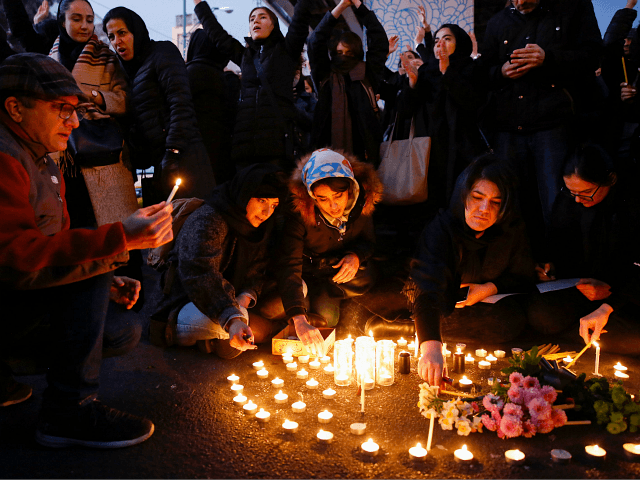 """Iranians light candles for the victims of Ukraine International Airlines Boeing 737 during a gathering in front of the Amirkabir University in the capital Tehran, on January 11, 2020. - Iran said it """"unintentionally"""" shot down a Ukrainian passenger jet, killing all 176 people aboard, in an abrupt about-turn after …"""
