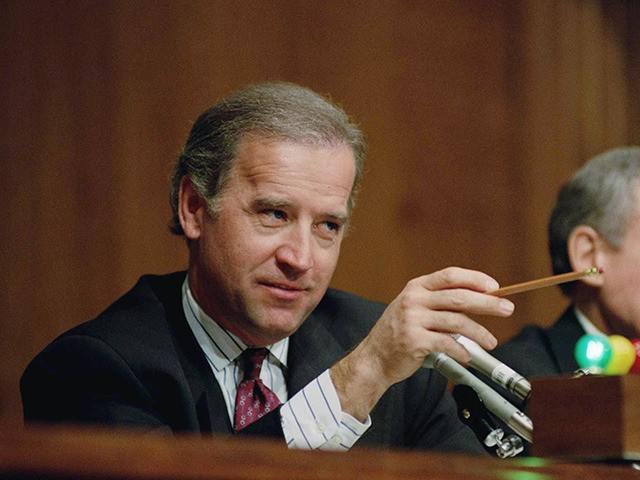 Sen. Joseph Biden, D-Del., chairman of the Senate Judiciary Committee, left, questions Attorney General-designate Zoe Baird during a hearing of the committee on Capitol Hill in Washington, Jan. 21, 1993. Sen. Orrin Hatch, R-Utah, ranking Republican on the committee awaits his turn. (AP Photo/Ron Edmonds)