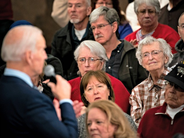 AMES, IA - JANUARY 21: People listen as Democratic presidential candidate, former Vice President Joe Biden speaks during an event on January 21, 2020 in Ames, Iowa. With less than two weeks to go until the Iowa caucus, the candidates are making their case to voters in the state of …