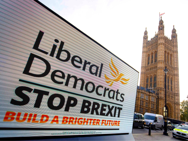 A poster van shows the Liberal Democrat slogan for the upcoming general election in central London on October 3, 2019. - Britain will go to the polls on December 12 in a bid to unlock the protracted Brexit deadlock. (Photo by Tolga AKMEN / AFP) (Photo by TOLGA AKMEN/AFP via …