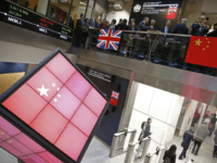 An illuminated cube bearing the Chinese flag is pictured in the entrance foyer of the London Stock Exchange, after British Chancellor of the Exchequer Philip Hammond and Bank of China chairman Tian Guoli opened the markets for the start of trading, in central London on November 10, 2016, as part …