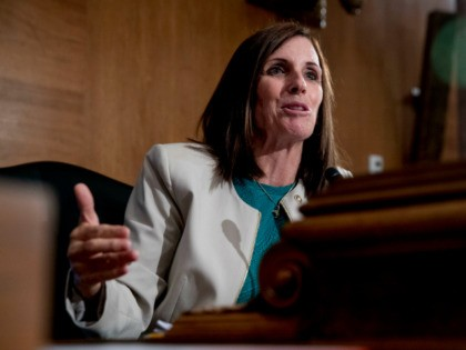 """Sen. Martha McSally, R-Ariz., speaks at a Senate Banking Committee hearing on """"Housing Finance Reform: Next Steps"""" on Capitol Hill, Tuesday, Sept. 10, 2019, in Washington. Trump administration officials appear before Congress to defend their plan for ending government control of Fannie Mae and Freddie Mac. (AP Photo/Andrew Harnik)"""