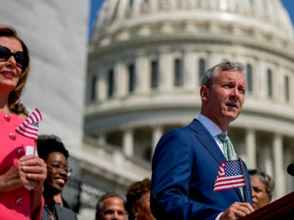 Rep. Matt Cartwright, D-Penn., right, accompanied by House Speaker Nancy Pelosi of Calif., left, and other House Democrats, speaks during a news conference on the first 200 days of the 116th Congress at the House East Front Steps of the Capitol building, in Washington, Thursday, July 25, 2019. (AP Photo/Andrew …