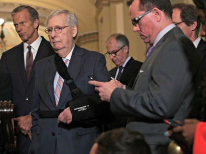 WASHINGTON, DC - SEPTEMBER 10: U.S. Senate Majority Leader Sen. Mitch McConnell (R-KY) and Senate Majority Whip Sen. John Thune (R-SD) listen during a news briefing after the weekly Senate Republican policy luncheon September 10, 2019 at the U.S. Capitol in Washington, DC. Senate GOPs held the weekly luncheon to …