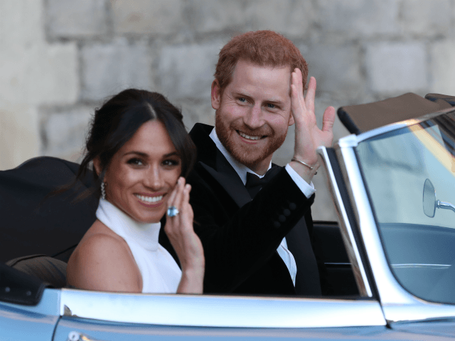WINDSOR, UNITED KINGDOM - MAY 19: Duchess of Sussex and Prince Harry, Duke of Sussex wave as they leave Windsor Castle after their wedding to attend an evening reception at Frogmore House, hosted by the Prince of Wales on May 19, 2018 in Windsor, England. (Photo by Steve Parsons - …