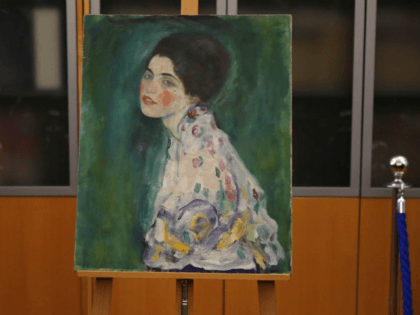 The painting which was found last December near an art gallery and believed to be the missing Gustav Klimt's painting 'Portrait of a Lady' is displayed during a press conference in Piacenza, Italy, Friday, Jan. 17, 2020. Art experts have confirmed that a stolen painting discovered hidden inside an Italian …