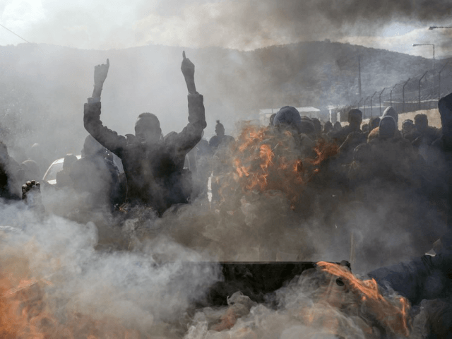 Refugees and migrants burn garbage bins and chant slogans as they demonstate outside Moria camp, following the stabbing death of an 20-year-old man from Yemen in the Greek island of Lesbos, Friday, Jan, 17, 2020. Authorities arrested a 27-year-old Afghan migrant in connection with the incident. Overcrowding at Moria has …