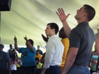 Democratic presidential candidate and South Bend, Indiana mayor Pete Buttigieg (C) attends a community building event hosted by Christ Temple Apostolic Church on June 29, 2019 in South Bend, Indiana. The event was held as the funeral for Eric Logan was being held in nearby Mishawaka. Logan was shot and …