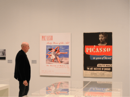 MADRID, SPAIN - APRIL 03: A member of the press views former posters of Picasso exhibitions during the presentation of the exhibition 'Pity and Terror in Picasso: The Path to Guernica' at the Museo Reina Sofia on April 3, 2017 in Madrid, Spain. The exhibition will celebrate the the 80th …