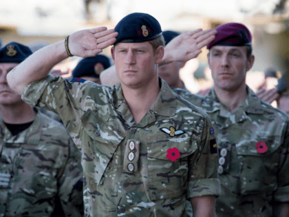 KANDAHAR, AFGHANISTAN - NOVEMBER 09: Prince Harry salutes as the Last Post is played as he joins British troops and service personal remaining in Afghanistan and also International Security Assistance Force (ISAF) personnel and civilians as they gather for a Remembrance Sunday service at Kandahar Airfield November 9, 2014 in …