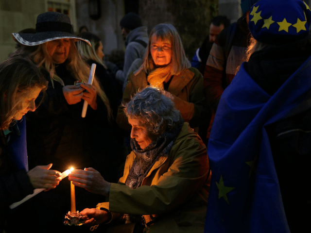 Anti-Brexit activists hold candles during a candlelight vigil organised by civil rights group New Europeans outside Europe House, central London on January 31, 2020 as Britain prepares to leave the European Union. - Brexit supporters gathered outside parliament on Friday to cheer Britain's departure from the European Union following three years of epic political drama -- but for others there were only tears. After 47 years in the European fold, the country leaves the EU at 11:00pm (2300 GMT) on Friday, with a handful of the most enthusiastic supporters gathering opposite the Houses of Parliament 12 hours before the final countdown. (Photo by ISABEL INFANTES / AFP) (Photo by ISABEL INFANTES/AFP via Getty Images)