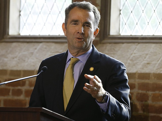 Virginia Gov. Ralph Northam addresses a commemorative meeting of the Virginia General Assembly on the 400th anniversary of the first House of Burgess meeting at a church in Historic Jamestown Va. on the site where the meeting took place Tuesday July 3