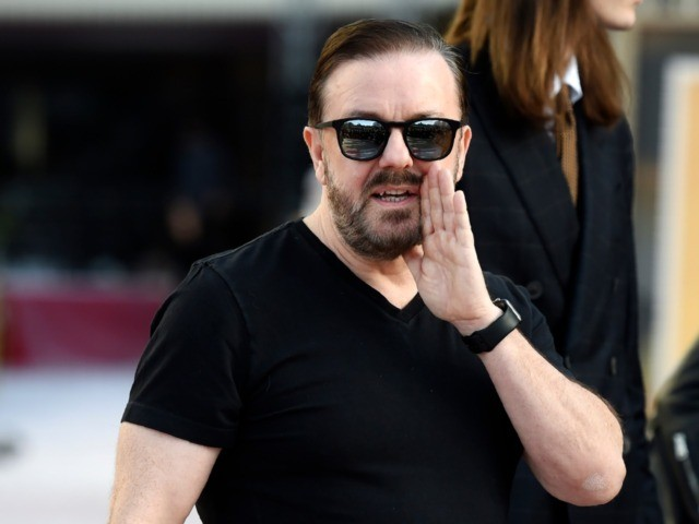 Ricky Gervais, host of this Sunday's 77th annual Golden Globe Awards, banters with members of the media during Preview Day for the Globes at the Beverly Hilton, Friday, Jan. 3, 2020, in Beverly Hills, Calif. (AP Photo/Chris Pizzello)