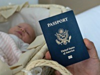 In this photo taken on Jan. 24, 2019, Denis Wolok, the father of 1-month-old Eva's father, shows the child's U.S. passport during an interview with The Associated Press in Hollywood, Fla. Every year, hundreds of pregnant Russian women, like Wolok's wife, Olga Zemlyanaya, travel to the United States to give …