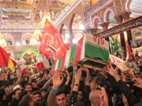"Mourners carry the coffins of slain Iraqi paramilitary chief Abu Mahdi al-Muhandis, Iranian military commander Qasem Soleimani and eight others inside the Shrine of Imam Hussein in the holy Iraqi city of Karbala,during a funeral procession on January 4, 2020. - Thousands of Iraqis chanting ""Death to America"" today as …"