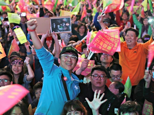 Supporters of Taiwan's 2020 presidential election candidate, Taiwan president Tsai Ing-wen cheer for Tsai's victory in Taipei, Taiwan, Saturday, Jan. 11, 2020. (AP Photo/Chiang Ying-ying)