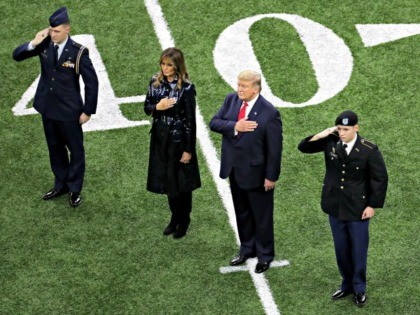 NEW ORLEANS, LOUISIANA - JANUARY 13: (L-R) First Lady Melania Trump and U.S. President Donald Trump stand for the national anthem prior to the College Football Playoff National Championship game between the Clemson Tigers and the LSU Tigers at Mercedes Benz Superdome on January 13, 2020 in New Orleans, Louisiana. …