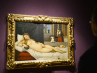 "A woman looks at Titian's ""Venus of Urbino"" on April 23, 2013 in Venice, during the ""Manet Return to Venice"" exhibition, which runs until 18 August 2013, at the Doge's Palace in Venice. Edouard Manet's ""Olympia"" will be appearing alongside the a masterpice of Renaissance and source of ispiration for …"