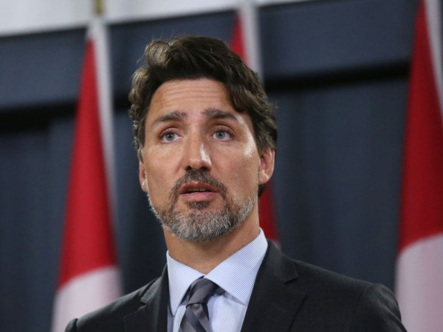"Canadian Prime Minister Justin Trudeau speaks at a press conference in Ottawa on January 11, 2020. Trudeau announced that a team of Canadian investigators is expected in Tehran within hours to ""establish a presence on the ground to support Canadian families."" - Iran said on January 11, it ""unintentionally"" shot …"