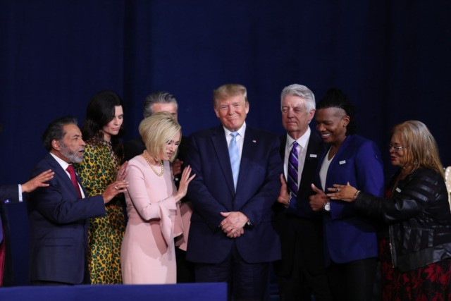MIAMI, FLORIDA - JANUARY 03: Faith leaders pray over President Donald Trump during a 'Evangelicals for Trump' campaign event held at the King Jesus International Ministry on January 03, 2020 in Miami, Florida. The rally was announced after a December editorial published in Christianity Today called for the President Trump's …