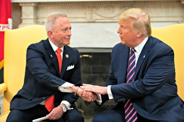 WASHINGTON, DC DECEMBER 19: (L-R) U.S. Rep. Jeff Van Drew of New Jersey, who has announced he is switching from the Democratic to Republican Party, shakes hands with U.S. President Donald Trump in the Oval Office of the White House on December 19, 2019 in Washington, DC. Van Drew voted …