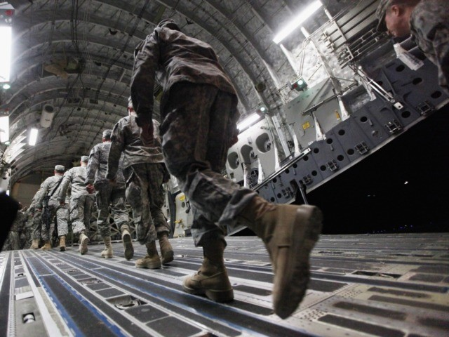 NASIRIYAH, IRAQ - DECEMBER 17: Soldiers from the 3rd Brigade, 1st Cavalry Division board a C-17 transport plane to depart from Iraq at Camp Adder, now known as Imam Ali Base, on December 17, 2011 near Nasiriyah, Iraq. Around 500 other troops from the 3rd Brigade, 1st Cavalry Division ended …