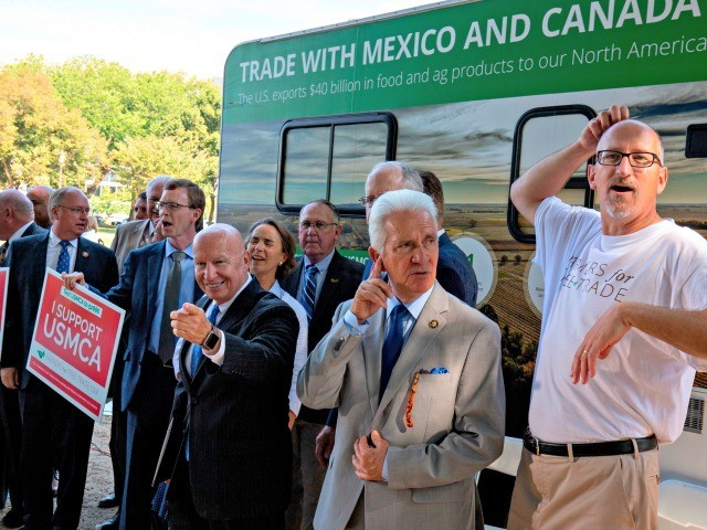 US Representative Kevin Brady (C) poses for photos with his colleagues after a rally for the passage of the US-Mexico-Canada Agreement (USMCA) near the US Capitol in Washington, DC, on September 12, 2019. (Photo by Alastair Pike / AFP) (Photo credit should read ALASTAIR PIKE/AFP via Getty Images)