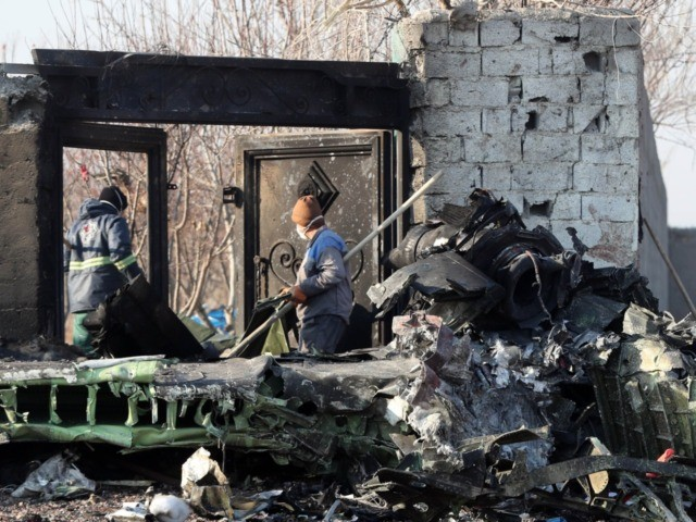 EDITORS NOTE: Graphic content / Rescue teams work amidst debris after a Ukrainian plane carrying 176 passengers crashed near Imam Khomeini airport in the Iranian capital Tehran early in the morning on January 8, 2020, killing everyone on board. - The Boeing 737 had left Tehran's international airport bound for …