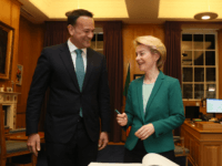 "Ireland's Prime Minister Leo Varadkar stands with European Commission President Ursula von der Leyen as she signs the Visitors' Book during their meeting at Government Buildings in Dublin, on January 15, 2020. - The European Union's top official said Wednesday the bloc was ready to work ""day and night"" to …"