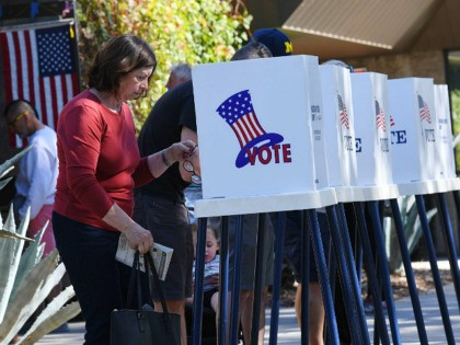 People vote at outdoor booths during early voting for the mid-term elections in Pasadena, California on November 3, 2018. (Photo by Mark RALSTON / AFP) (Photo credit should read MARK RALSTON/AFP via Getty Images)