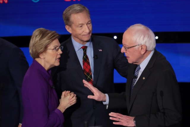 DES MOINES, IOWA - JANUARY 14: Sen. Elizabeth Warren (D-MA) and Sen. Bernie Sanders (I-VT) speak as Tom Steyer looks on after the Democratic presidential primary debate at Drake University on January 14, 2020 in Des Moines, Iowa. Six candidates out of the field qualified for the first Democratic presidential …