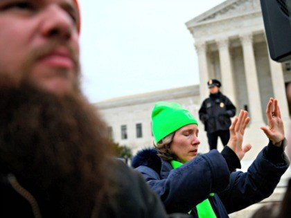 Anti-abortion advocates pray in front of the US Supreme Court while participating in the 47th annual March For Life in Washington, DC on January 24, 2020. - Activists gathered in the nation's capital for the annual event to mark the anniversary of the Supreme Court Roe v. Wade ruling that …