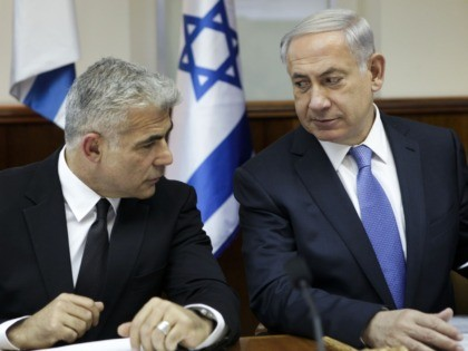 Israeli Prime Minister Benjamin Netanyahu (R) speaks with Finance Minister Yair Lapid during a cabinet meeting in Jerusalem on October 7, 2014. AFP PHOTO / POOL /DAN BALILTY (Photo credit should read DAN BALILTY/AFP via Getty Images)