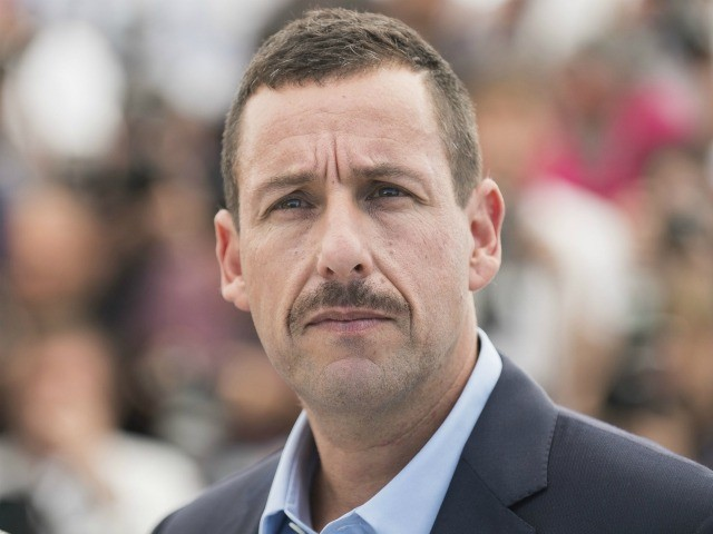 Adam Sandler poses for photographers during the photo call for the film The Meyerowitz Stories at the 70th international film festival, Cannes, southern France, Sunday, May 21, 2017. (Photo by Arthur Mola/Invision/AP)
