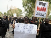 "Thousands of women in black, one of them carrying a placard reading ""Why Kill Children ?"" as they march in protest at the slaughter of scores of mainly Christian villagers -- many of them women and children. Wielding pictures of dead children and carrying Bibles in their hands, wailing Nigerian …"