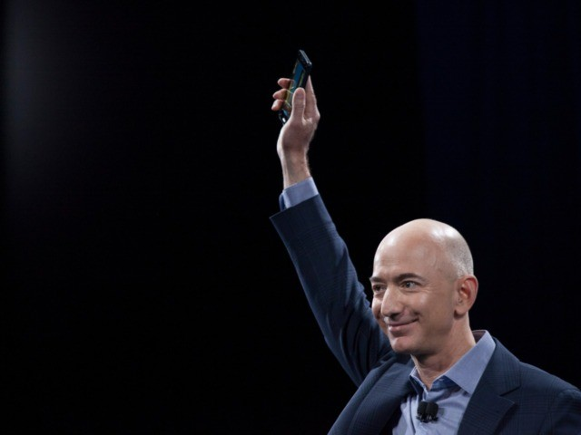 SEATTLE, WA - JUNE 18: Amazon.com founder and CEO Jeff Bezos presents the company's first smartphone, the Fire Phone, on June 3, 2014 in Seattle, Washington. (Photo by David Ryder/Getty Images)