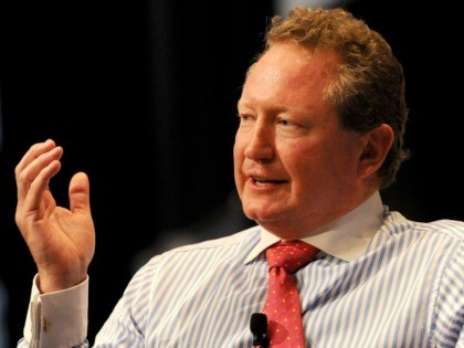 "Mining billionaire Andrew ""Twiggy"" Forrest speaks during a business luncheon in Sydney on April 17, 2012. Forrest, founder and Chairman of Fortescue Metals Group and the Australian Children's Trust, graduated in economics and politics before building a distinguished career in investment banking, mining and farming, creating some of the largest …"