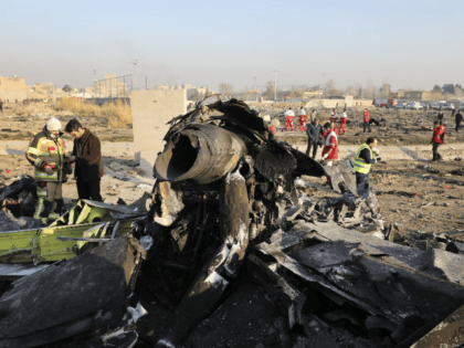 """In this Wednesday, Jan. 8, 2020 file photo debris at the scene where a Ukrainian plane crashed in Shahedshahr southwest of the capital Tehran, Iran. Two U.S. officials said Thursday that it was """"highly likely"""" that an Iranian anti-aircraft missile downed a Ukrainian jetliner late Tuesday, killing all 176 people …"""
