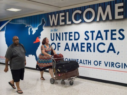 "International travelers leave the Customs and Immigration area of Dulles International Airport (IAD) June 29, 2017, outside Washington, DC, in Dulles, Virginia. The US began implementing a ban on travelers from six mostly Muslim countries, amid fresh controversy about who is exempt: those with ""close family relationships"" can get visas, …"
