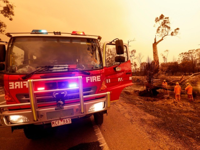 EAST GIPPSLAND, AUSTRALIA - JANUARY 04: Fire crews put out spot fires on January 04, 2020 in Sarsfield, Australia. Two people are dead and 28 remain missing following bushfires across the East Gippsland area, with Victorian premier Daniel Andrews declaring a state of disaster in the region. Thousands of people …