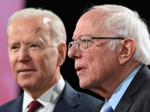 Democratic presidential hopefuls former Vice President Joe Biden (L) and Vermont Senator Bernie Sanders arrive to participate in the sixth Democratic primary debate of the 2020 presidential campaign season co-hosted by PBS NewsHour & Politico at Loyola Marymount University in Los Angeles, California on December 19, 2019. (Photo by Robyn …