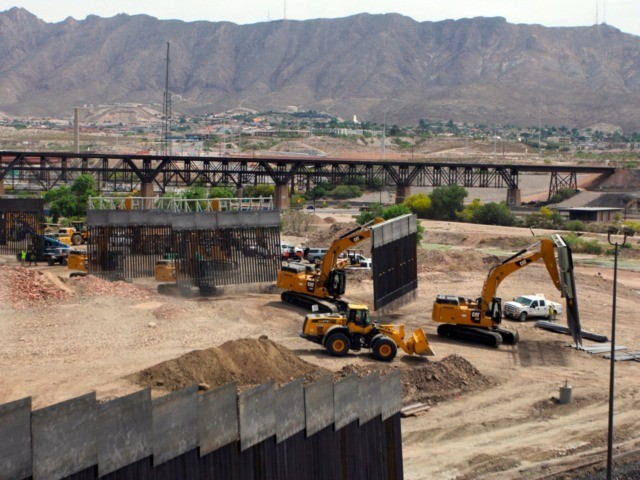 Workers build a border fence in a private property located in the limits of the US States of Texas and New Mexico taken from Ciudad Juarez, Chihuahua state, Mexico on May 26, 2019. (Photo by HERIKA MARTÍNEZ / AFP) (Photo credit should read HERIKA MARTINEZ/AFP via Getty Images)