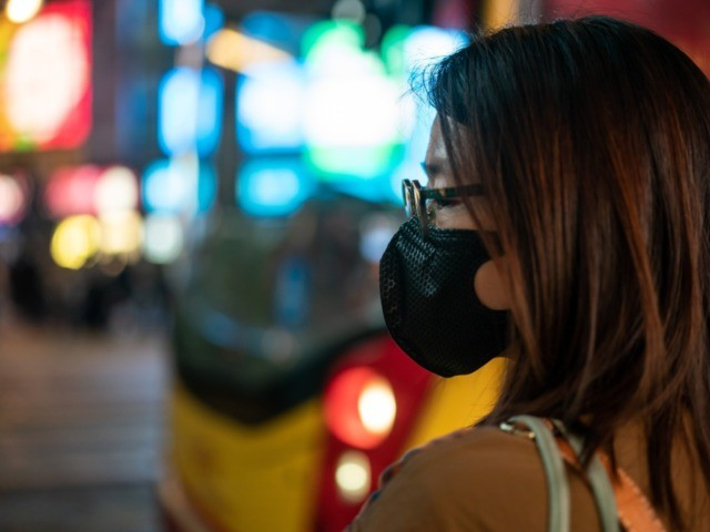 HONG KONG, CHINA - JANUARY 23: Pedestrians wear face masks as they walk through a crosswalk in Causeway Bay district on January 23, 2020 in Hong Kong, China. Hong Kong reported its first two cases of Wuhan coronavirus infections as the number of those who have died from the virus …
