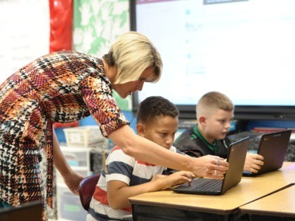 Amy Grady, who is running as an independent for a seat in the West Virginia state Senate, teaches in her classroom at Leon Elementary October 18, 2018 in Leon, West Virginia. - Teachers like Amy Grady successfully went on strike this year across West Virginia demanding better health care and …