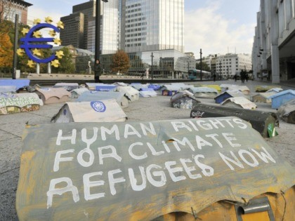 """A miniature tent inscribed with the words """"Human Rights for Refugees Now"""" outside the headquarters of the European Central Bank (ECB) in Frankfurt on October 17, 2008. German artist Hermann Josef Hack created a """"Climate Refugee Camp"""" made up of three hundred miniature tents to call attention on the plight …"""